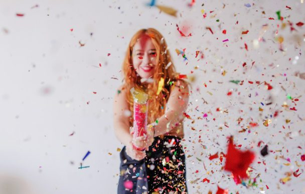 confetti-flying-in-air-and-girl-behind_23-2147651744